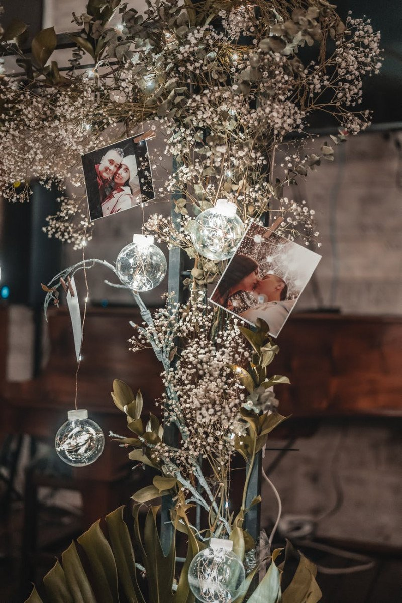 romantic photos attached on blooming flower with shiny balls