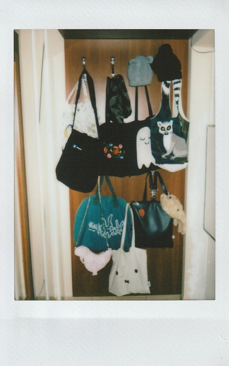 various tote bags hanging by entrance
